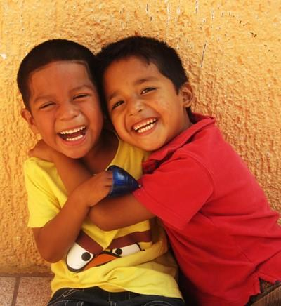 School boys smiling and hugging